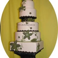 Green Flower Wedding Cake  This was inspired by a flowered table cloth. All the decorations are made of fondant and edible. The stand which is made of sugar was...