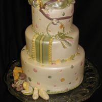 Baby Shower Cake  The theme was 2 peas in a pod, we placed the pod in front of the baby diaper bag. The cake was made to match the color scheme of the...