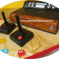 Atari 2600 Cake  This lovely game console is completely edible. It is all cake covered in fondant. The Joysticks are cake with poured chocolate handles...
