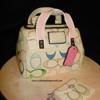 Coach Purse Cake   This one was for an older lady who always wanted a coach purse, I do believe she got the real thing too