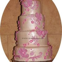 Pink Wedding Cake   The cakes inspiration was the brides dress patterns
