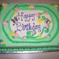 Grandma's Green Birthday Cake 1/2 White/ 1/2 Chocolate and Wasc cake with buttercream frosting and fondant flowers.