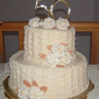 50_Crop.jpg Vanilla cake with Raspberry filling and BC icing. Flowers are Fondant Roses. Made for a 50th anniversary