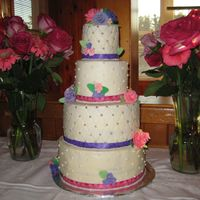 Cakes_071.jpg A cake for my grandparents 65th wedding anniversary. The bottom layer was carrot cake with cream cheese icing. The 2nd and top layer were...