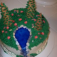 Forest Cake I made this for my cake class. The class was all about using special tips. I decided to add the waterfall out of piping gel to give it...