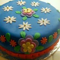 First Fondant This is the first fondant work I have ever done. I went for bright colors just so I could see how it would all come out and I figured it...