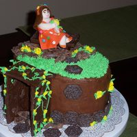 Shreck's Dream Garden girl character fabricated from fondant, Hershey's chocolate bench, rocks, and trellis.