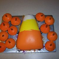 Candy Corn And Pumpkins candy cake and pumpkin cup cakes
