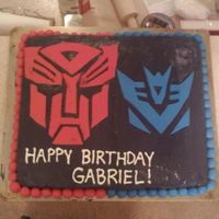 Transformers.jpg Made this for my brother's birthday. First time I really used fondant! It was two cakes, one chocolate chip and the other one was just...