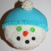 Snow Man Cupcake   made for my daughter's 2nd grade class.