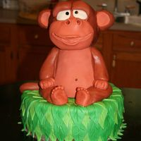 Monkey Cake   Monkey is rice krispie treats covered fondant.Cake is yellow, covered in chocolate bc with green fondant leaves on top