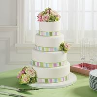 Striped Wedding Cake Hi sugar friends -BloomNet cake # 4I loved how this one turned out! Loved the colors. The cake has a main ribbon with cut out pieces of...
