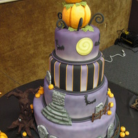 Halloween Wedding Cake Hi sugar friends!This cake was for my web master/DVD production dude. They both LOVE Halloween, so they decided to have their wedding on...