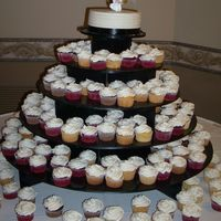 Wedding Cupcakes Cupcakes for my friends wedding (chocolate, yellow, and red velvet). The cake on top is yellow with strawberry filling. All buttercream...