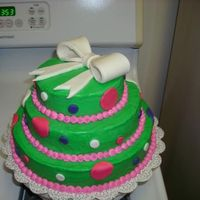 L_A6D497C768B8C2F3B5C5Bbbdd7Df.jpg Buttercream with Fondant accents and fondant bow.