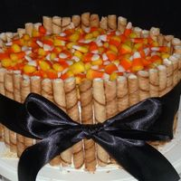 Halloween! Candy corn and Piroline cookies on top of Pumpkin spice cake w/ vanilla BC. Tied with black ribbon.
