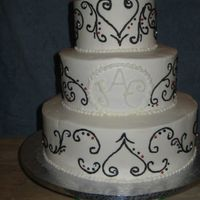 Black Swirls On White Cake This was my 3rd wedding cake and it was a fairly scary one. She wanted a white cake with black swirls and at first it sounded easy and I...