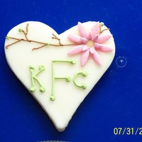 Monogram Bridal Shower Cookie NFSC with icing and royal icing writing and twigs. Flower is gumpaste. Tweaked an idea I saw on CC.