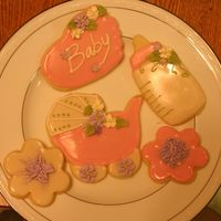 Baby Girl Cookies sugar cookies with icing and RI flowers and deco. It is hard to see but there is luster dust on them as well. They were very fun to make. I...