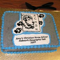 Geography Fair Cake Just a basic sheet cake. My second attempt at FBCT. We had just selected our logo a couple of weeks ago and I wanted to incorporate this.