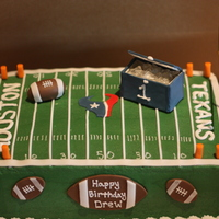Football 1St Birthday Cake 1st birthday party with a football theme. All footballs are fondant, the cooler is gumpaste. The ice in the cooler was made with isomalt.