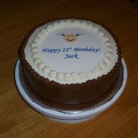 Bday Cake W/edible Image White four layer cake, strawberry filling, choc bc sides, white bc top.