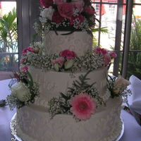 "White Wedding Cake I made this cake for a friends wedding. It is vanilla cake with vanilla butter cream. (14"", 10"", 6"")The florist made the..."