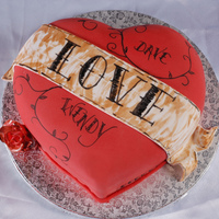 Heart Tattoo Choc fudge with vanilla bc under fondant...fluffy choc bc filling.Banner fondant