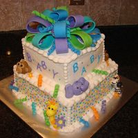 Zoo Animals Babyshower Cake This is a two tier cake with buttercream icing. All animals, flowers, and the bow I handmade with fondant.