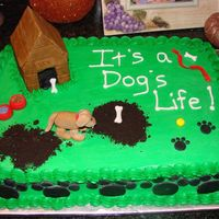 Dog's Life Cake This is just a sheetcake covered in buttercream icing to look like a yard with a dog. I made the dog house, dog, his bowls (with fondant...