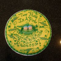 Two Peas In A Pod This is a 14 inch cake iced in buttercream with fondant peapods and Babies. The mother to be is having twin boys.