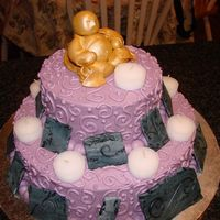 Budah Cake My sister and I love yoga so I call this our Namaste cake. It is a two tier cake with buttercream icing. I made the Budah out of fondant...