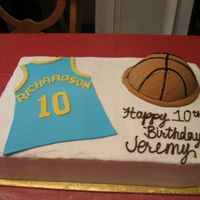 Jeremy's Basketball Cake For my nephew's 10th Birthday. Chocolate cake with cookies and cream filling, buttercream icing. The basketball is cake covered in...