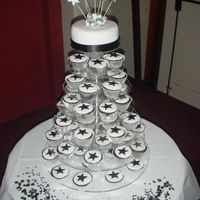 Star Cupcake Tower Chocolate mudd cupcakes and cutting cake. Fondant iced, over dark chocolate ganache. Theme colours for the wedding were black, silver and...