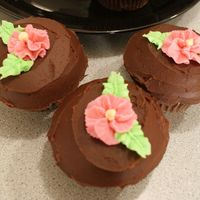 Chocolate Cuppies   Chocolate cupcakes w/ whipped chocolate ganache and buttercream flowers