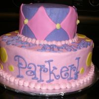 Parker's Bday My favorite cake to make! Two tiers buttercream with fondant accents!