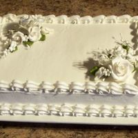 Bridal Shower Cake Used decopac royal icing bouquets. White cake and white icing.