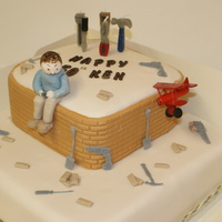 Bricks N Bobs this cake was made to order. The customer is a builder and flies As most of his flights end up in a crash i thought this would be amusing....