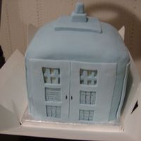 Dr Who's Tardis Sponge cakes stacked and covered with fondant decorated to resemble the Tardis. Colour not correct blue