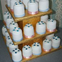 Life Saver Plain mini cakes fondant covered with life belt as topper to match wedding cake.