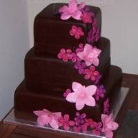 Brown And Pink Wedding Cake Chocolatey brown square wedding cake, 10, 8, 6, covered in fondant and embellished with handcrafted fondant flowers in pink, fuschia and...