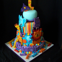 Jungle Safari 1St Birthday Cake Cake designed to match partyware. Chocolate and vanilla cake with vanilla buttercream, all decorations are fondant. The top tier was a...