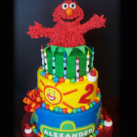 "Elmo Cake An Elmo themed cake for a little boys 2nd birthday. Elmo is RKT decorated with royal icing ""fur"", cake is frosted in buttercream..."