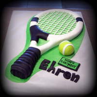 Tennis Racket And Ball Cake Hand carved tennis racket, fondant decorations and fondant ball.