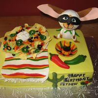 Skippyjon Jones Fiesta Birthday Cake Skippyjon Jones (children's book character...a Siamese cat that thinks he's a Chihuahua) Fiesta theme for my 7yr old son. 1 layer...