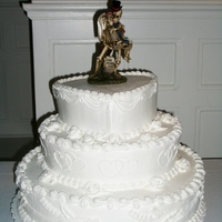 "A Halloween Wedding! Cake consisted of a white wedding cake with buttercream icing. The ""wedding"" cake topper was a groom skeleton holding bride..."