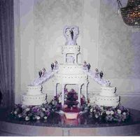Stairway And Fountain Wedding Cake Three center cakes with two 2-tier side cakes. All cakes are iced with a buttercream icing. All the cakes and fillings were different (due...