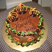 Happy Harvest Day! Chocolate cake, chocolate buttercream frosting with ganache trim and orange chocolate piped pumpkins. Yummy!