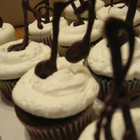 Music Note Cupcakes This was my first attempt with piping melted chocolate. I have done it one other time since then and had better control. **HInt: Pipe a...