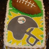 Steelers Football Cake Chocolate cake with buttercream icing and fondant accents.